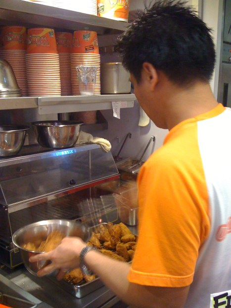 Chef about to mix sauce with wings