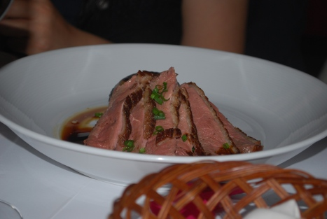 Green Tea Smoked Duck with Black Sticky Rice, Baby Bok Choy and Pomegranate Jus