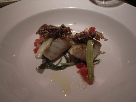 Sea Bass on Braised Baby Leek, Olive Oil, Citrus Sauce and Sancho Peppers